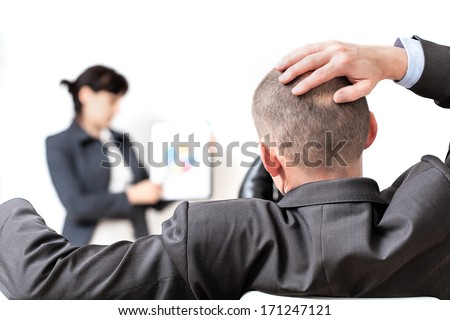 Closeup of a manager's head at a business meeting