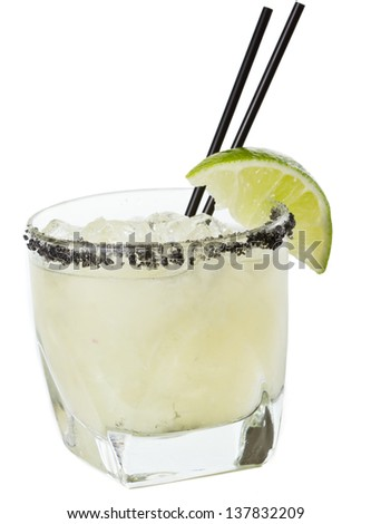 closeup of a margarita garnished with smoked black lava salt isolated on a white background - stock photo