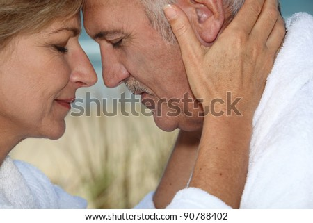 Closeup of a mature couple in love - stock photo
