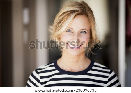 Closeup Of A Mature woman smiling At The Camera - stock photo
