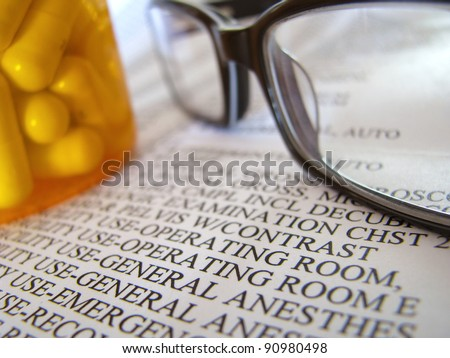 Closeup Of A Medical Hospital Bill, Prescription Medicine And Glasses - stock photo