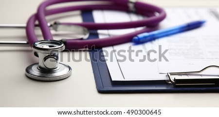 Closeup of a medical stethoscope with folder .