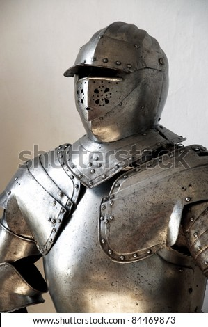 Closeup of a medieval knight's suit of armor and helmet - stock photo
