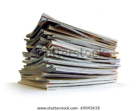 Closeup of a messy pile of old magazines with bending pages - stock photo