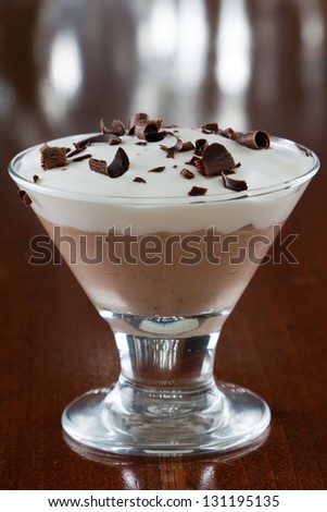 closeup of a mini chocolate martini glass layered with dark and milk chocolate with chocolate shavings on top