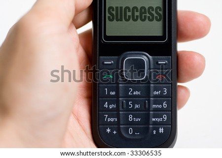 Closeup of a mobile phone with word success - stock photo