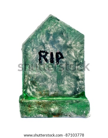 closeup of a moldy grave for Halloween on a white background