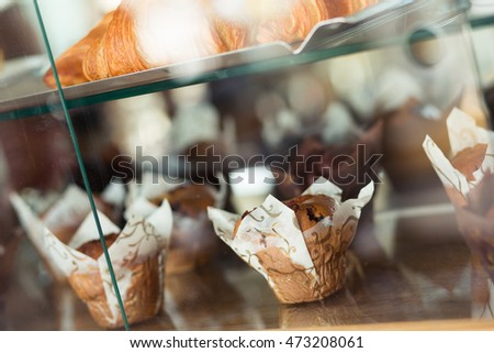 Closeup of a muffin on display in a French cafe