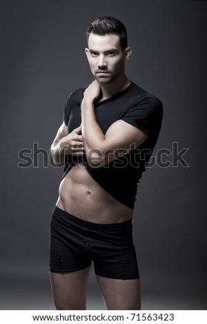 Closeup of a muscular handsome man in underwear - stock photo