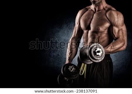 Closeup of a muscular young man lifting weights - stock photo