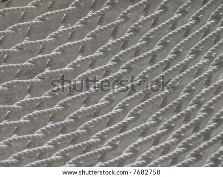 closeup of a net from a white hammock - stock photo