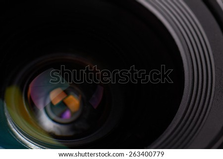 Closeup of a new photographic lens - stock photo