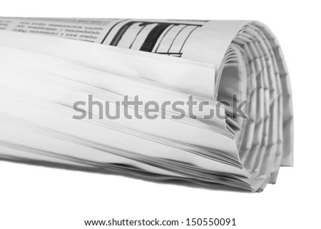 closeup of a newspaper roll on white  - stock photo