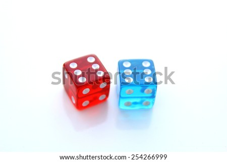 Closeup of a pair of color dices over white background - stock photo