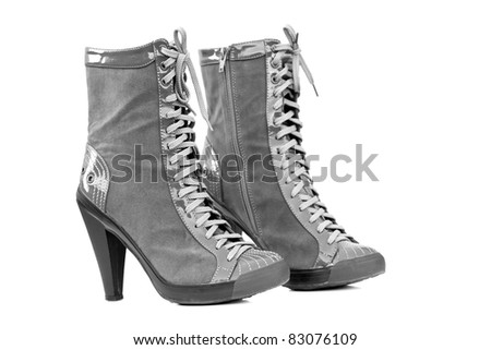 Closeup of a Pair of grey Boots with High Heels - stock photo