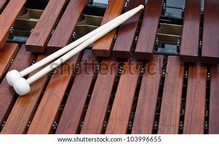 Closeup of a pair of mallets on a wooden marimba - stock photo