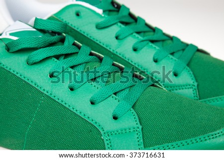 closeup of a pair of new green sneakers