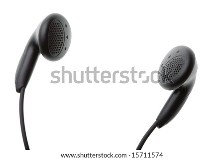 Closeup of a pair of small black headphones isolated against white background with copy space in centre - stock photo