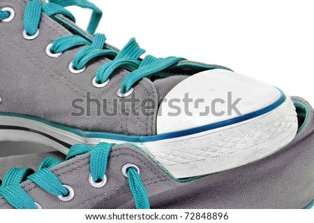 closeup of a pair of sneakers isolated on a white background - stock photo