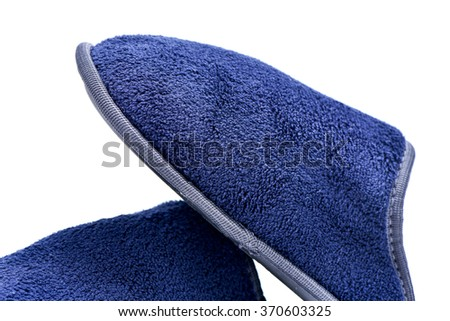 closeup of a pair of warm slippers on a white background - stock photo