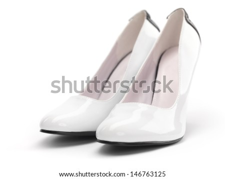 Closeup of a pair of white high heel womens shoes isolated on white background - stock photo