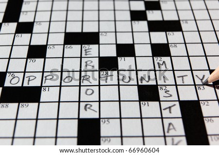 Closeup of a partially completed crossword puzzle with the word opportunity in focus - stock photo