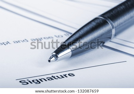 closeup of a pen and contract - stock photo