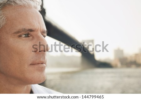 Closeup of a pensive man by river