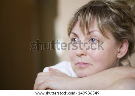 Closeup of a pensive middle aged woman - stock photo