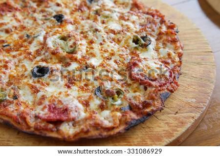 Closeup of a Pepperoni flat bread thin crust pizza  - stock photo