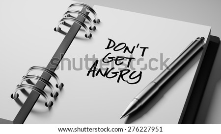 Closeup of a personal agenda setting an important date writing with pen. The words Don't get angry written on a white notebook to remind you an important appointment. - stock photo