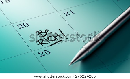 Closeup of a personal agenda setting an important date written with pen. The words Be Rich written on a white notebook to remind you an important appointment.