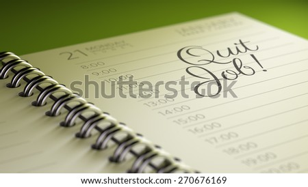 Closeup of a personal calendar setting an important date representing a time schedule. The words Quit job written on a white notebook to remind you an important appointment.