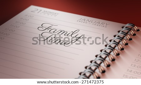 Closeup of a personal calendar setting an important date representing a time schedule. The words Family Time written on a white notebook to remind you an important appointment.