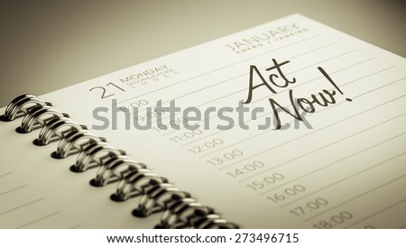 Closeup of a personal calendar setting an important date representing a time schedule. The words Act Now written on a white notebook to remind you an important appointment. - stock photo