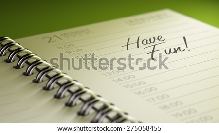 Closeup of a personal calendar setting an important date representing a time schedule. The words Have Fun written on a white notebook to remind you an important appointment. - stock photo