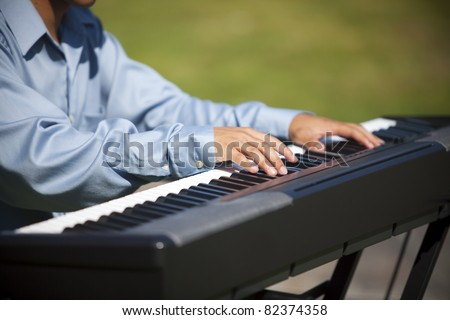 Closeup of a pianist playing a keyboard