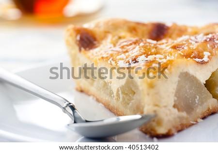 Closeup of a piece of an apple pie, shallow focus - stock photo