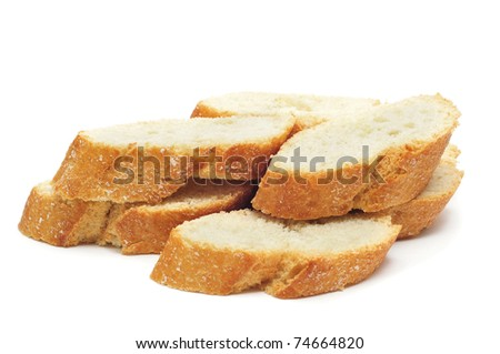 closeup of a pile of bread slices on a white background - stock photo