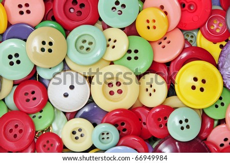 closeup of a pile of buttons of many colors - stock photo