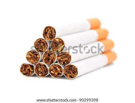 Closeup of a pile of cigarettes over white background - stock photo