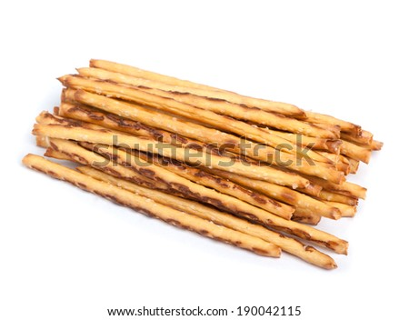 Closeup of a pile of delicious pretzel sticks isolated on white background