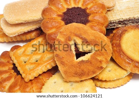 closeup of a pile of  different biscuits with different shapes