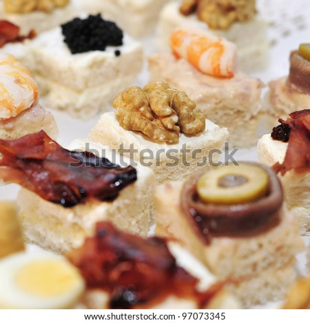closeup of a pile of different canapes