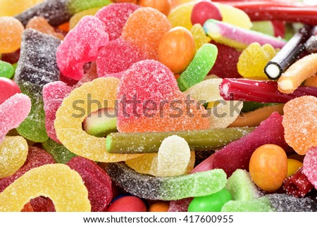 closeup of a pile of different candies, with different shapes and flavors - stock photo