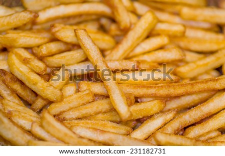 closeup of a pile of french fries - stock photo