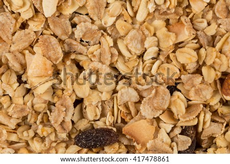 Closeup of a pile of muesli cereal breakfast oatmeal - stock photo