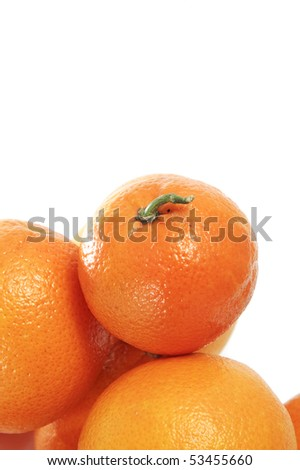 closeup of a pile of oranges isolated on a white background