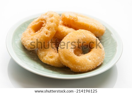 closeup of a pile of rosquillas, thai donuts