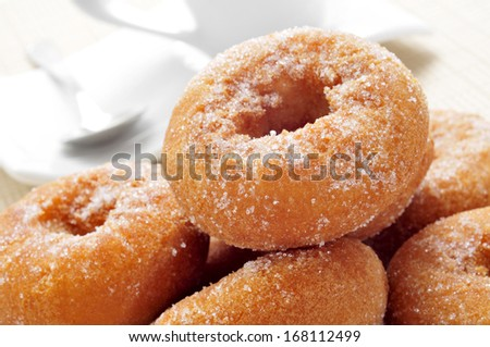closeup of a pile of rosquillas, typical spanish donuts, on a set table - stock photo